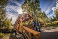 Greg-and-Katherine-exiting-covered-bridge-Salmo.jpg