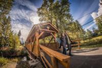 Greg-and-Katherine-exiting-covered-bridge-Salmo.jpg